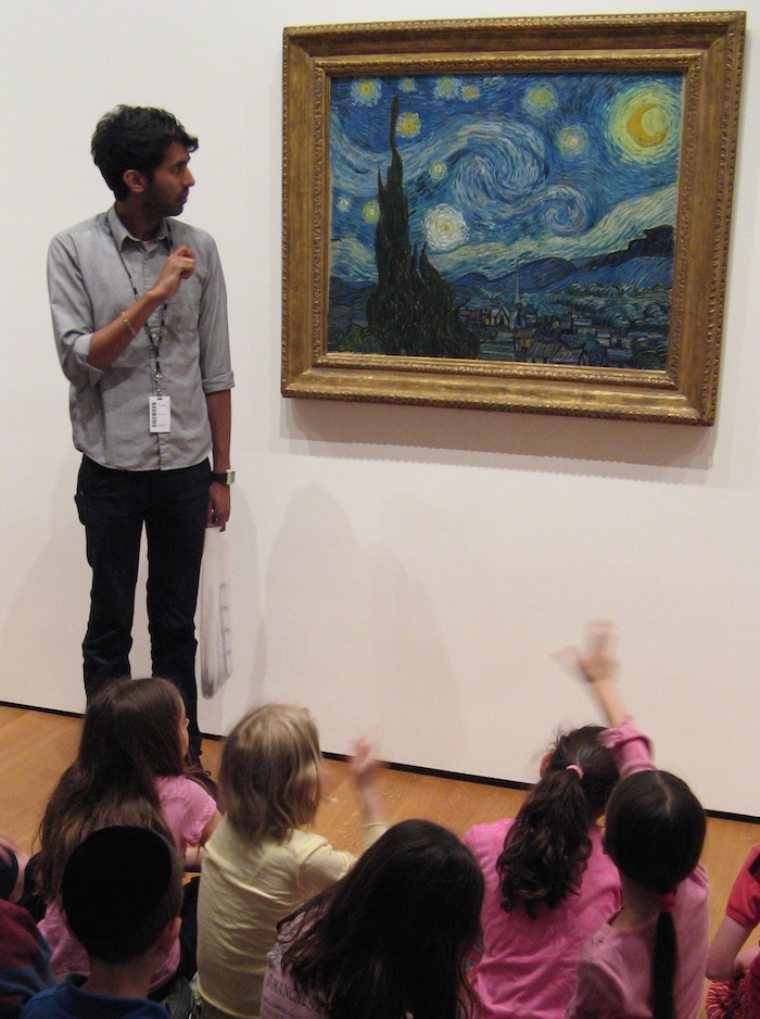 The Starry Night at the MET with a teacher standing and students sitting