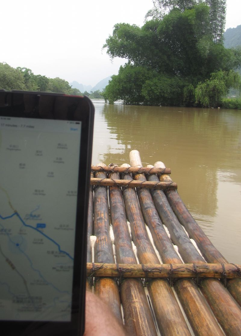Map app showing gps location while floating on bamboo raft in Yangshuo, China